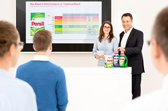 Male and female employee are holding a presentation about Persil.